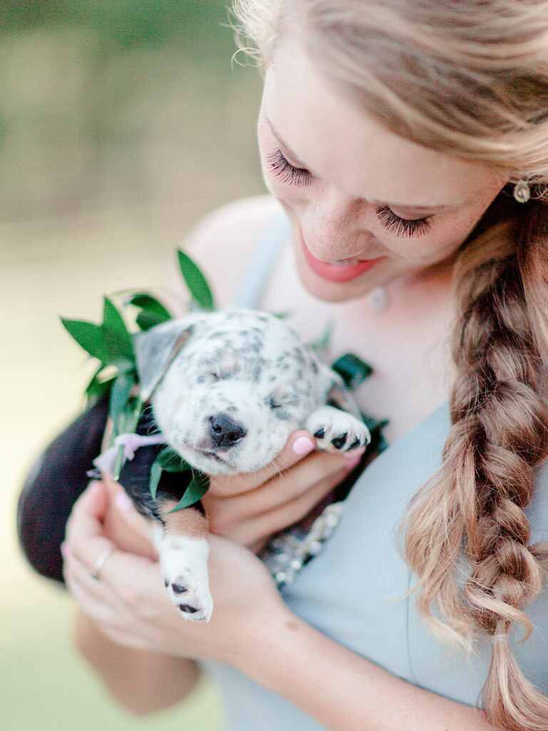 Bridesmaid with cute puppy bouquet