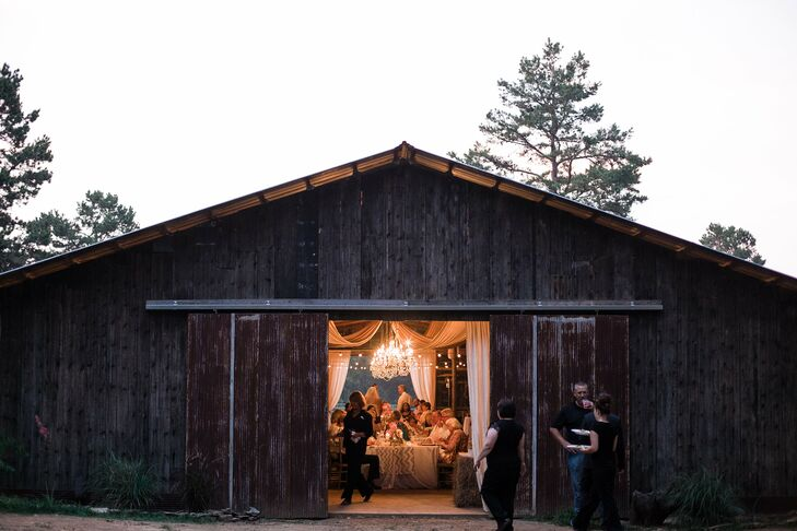 """The outdoor landscape and barn was absolute breathtaking for our ceremony and reception,"" Nikki says. ""We chose this location because of the chic rustic decor and our love of country life."""