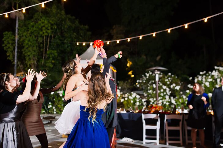 Guests Frantically Reach for the Tossed Bridal Bouquet