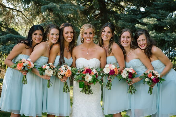 Lindsay's bridesmaids wore short, pale blue summertime dresses from Ann Taylor with a sweetheart neckline. The dresses recalled the watercolor tones in the invitation suite and place cards and were accented with diamond jewelry.
