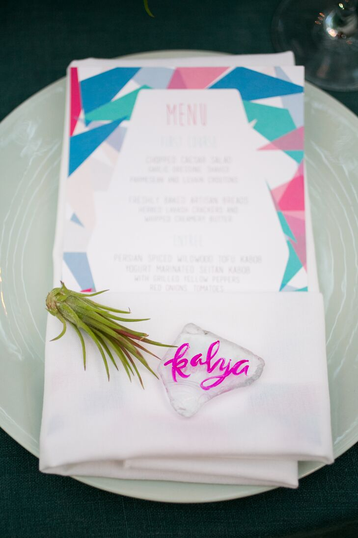 Lively geometric patterns bordered the menus, calling out the day's ocean-inspired blue and pink palette.