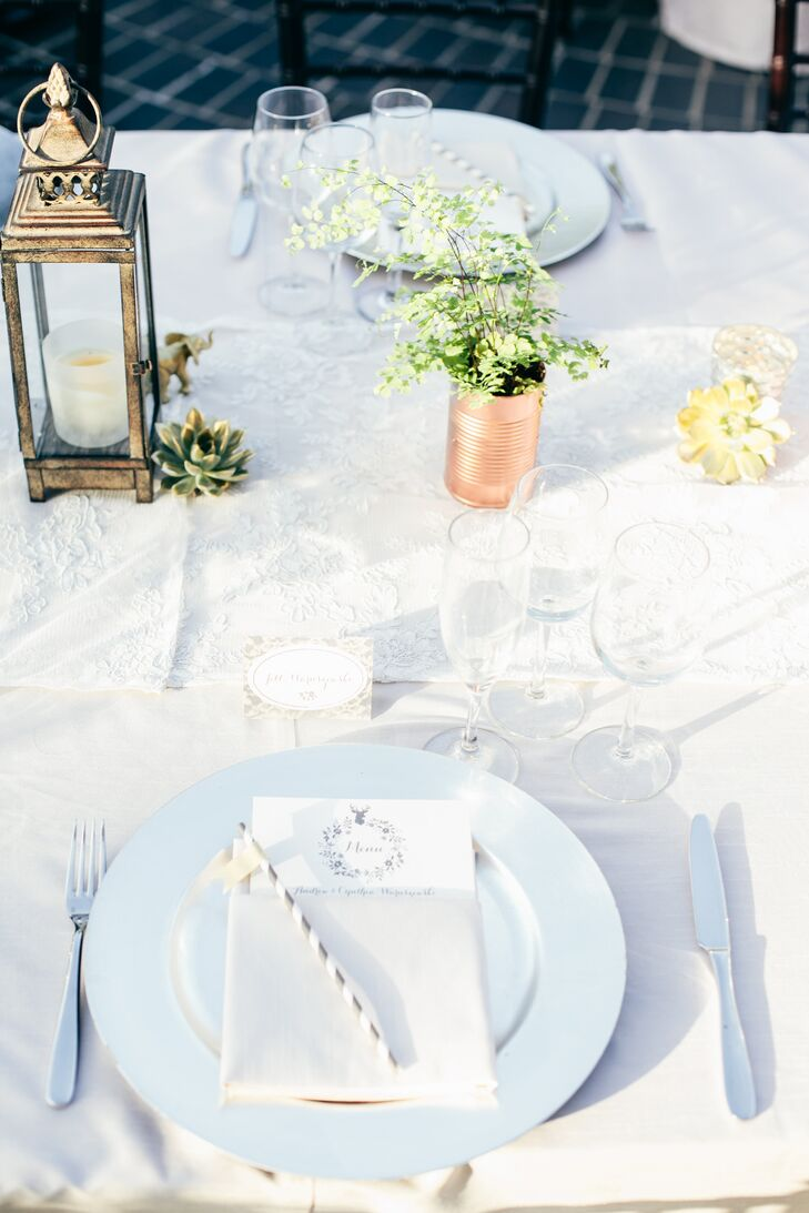 Each element of the decor tied together seamlessly. A gilded lace motif on the hand-crafted place cards played up the Chantilly lace table runners, while floral wreaths and antlers on the menus mirrored the whimsical centerpieces.