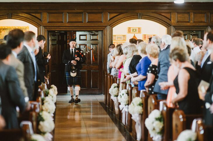 A bagpiper preceded Beth and her father down the aisle. The aisle was decorated with small bouquets of white hydrangeas.