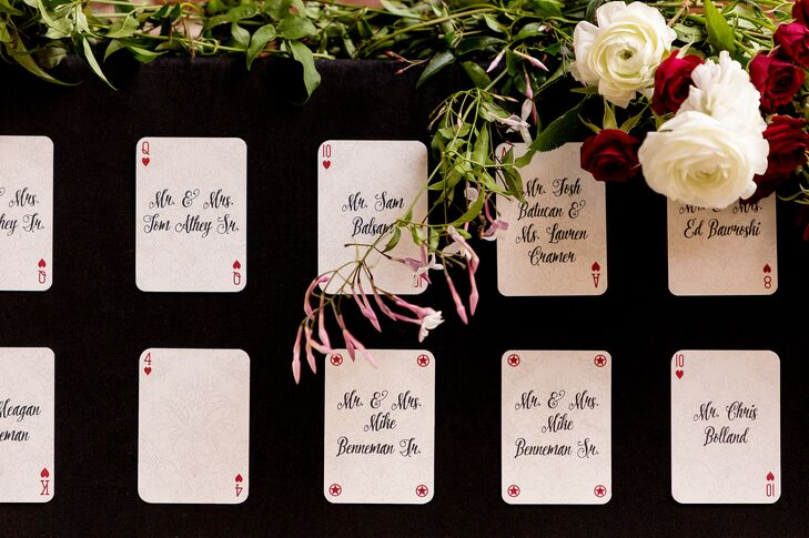 As a nod to their one-of-a-kind theme, Kelly and Richard guided guests to their seats with the help of whimsical hand-calligraphed playing cards. The number or symbol on the card corresponded to the guest's table assignment.