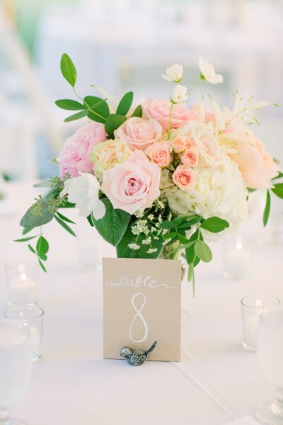 Studio 539 Flowers seriously delivered when it came to the wedding's floral arrangements. Her romantic creations, complete with all the classics—garden roses, peonies and hydrangeas—in soft peach, pink, white and coral hues filled the sailcloth tent with energy, life and a touch of romance.