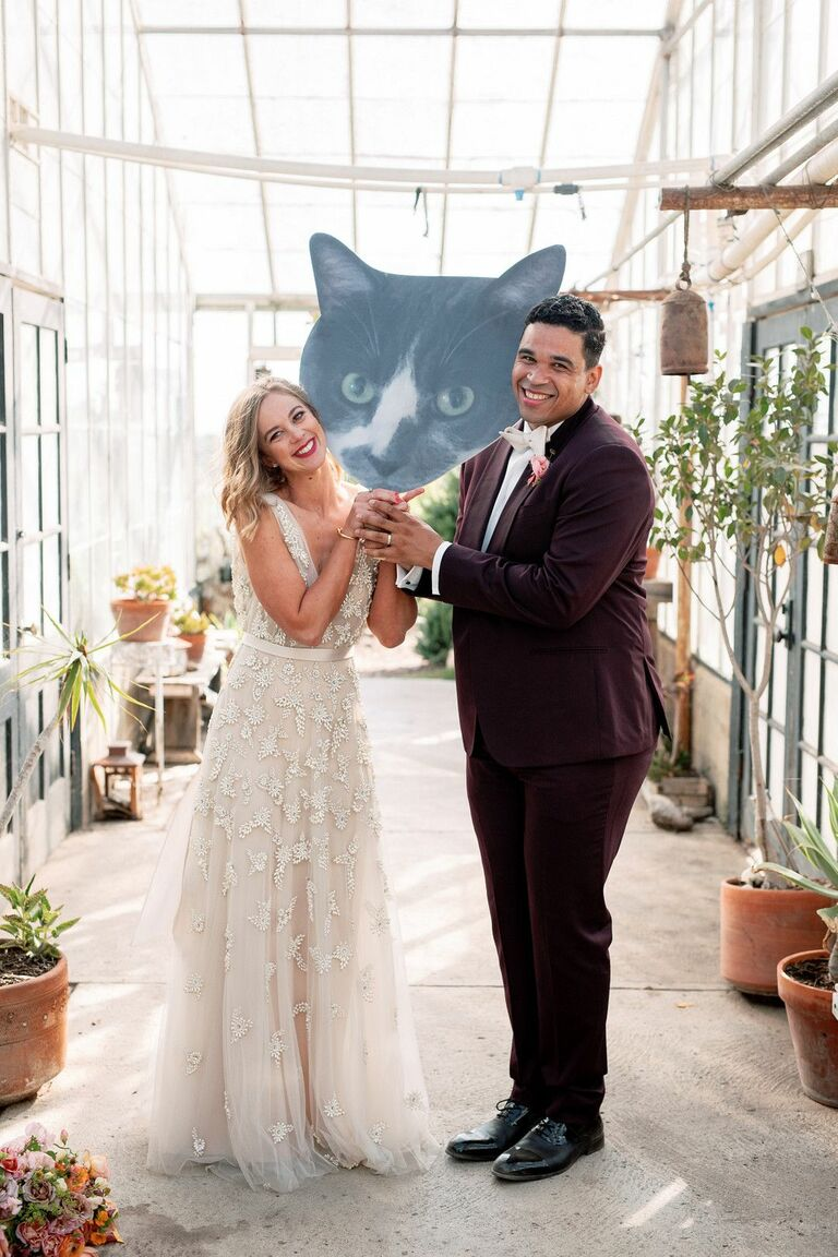 Couple holding giant cat cutout