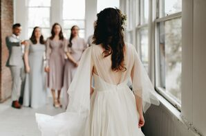 Ethereal Bridal Look with Airy Dress and Curled Down Hairstyle