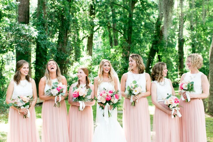 """The bridesmaids were dressed in simple cream lace tank tops paired with a dusty rose tulle maxi skirt. """"It was such a comfortable skirt and had the flowy, laid-back style I really loved,"""" Jamie says."""