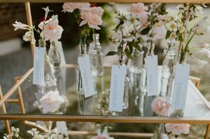 Romantic Escort Cards with Pink Flowers and Glass Vases