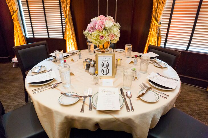 Gold-Framed Table Number with Floral Centerpiece