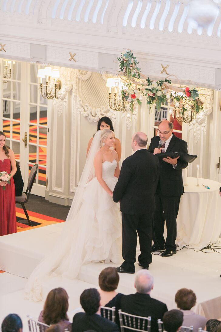 """The couple exchanged their vows indoors at the historic Blackstone Hotel. """"Light streamed into the room from the wall to wall windows overlooking Lake Michigan,"""" Jessica describes."""