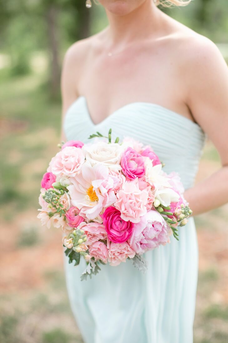 The bridesmaids carried a bright mix of pink blooms including peonies, stock, roses and vibrantly colored ranunculuses.