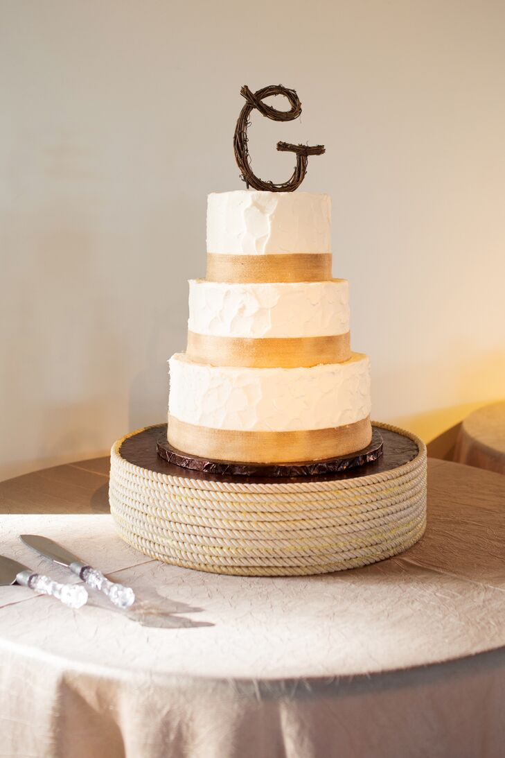 Ivory and Gold Wedding Cake With Rustic Topper