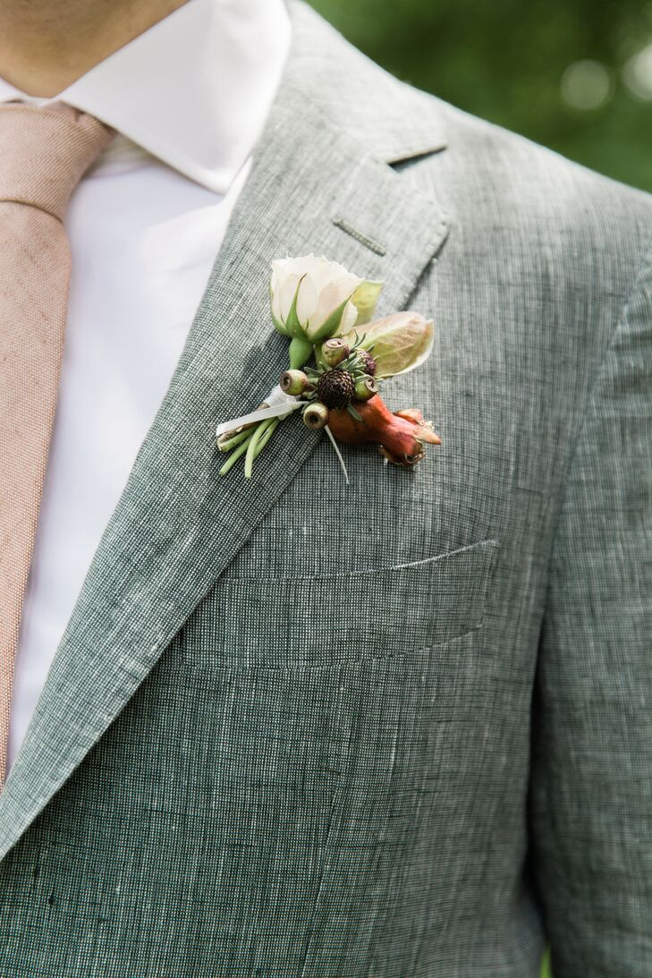 The groom's boutonniere echoed the foliage and florals of the Shavuot-inspired chuppah.