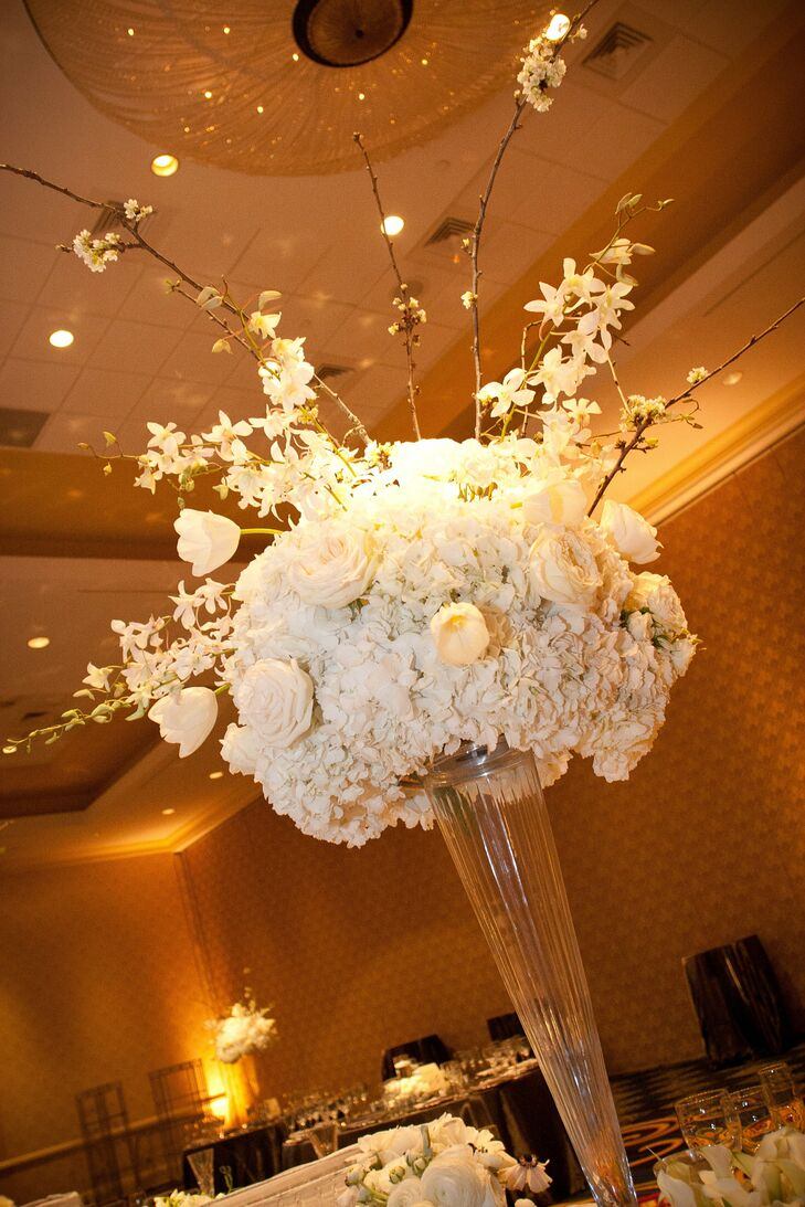 The flower arrangements were comprised of hydrangeas, roses, Hawaiian dendrobium orchids, sweet pea, cherry blossoms, ranunculuses and French tulips.