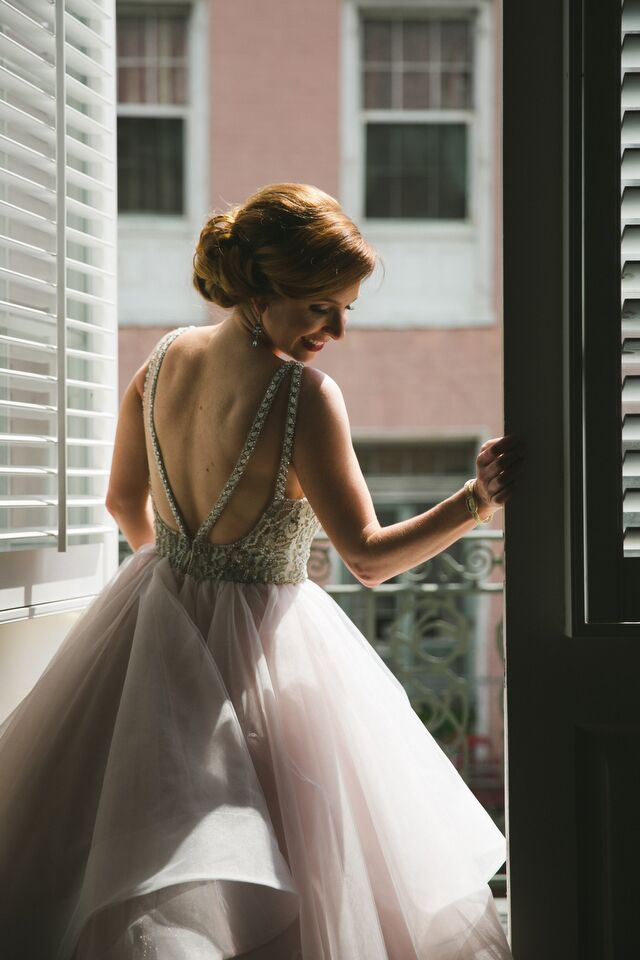 Virginia's wedding dress, by designer Hayley Paige, paired an intricately beaded bodice and dramatic exposed back with a softly tiered chiffon skirt.