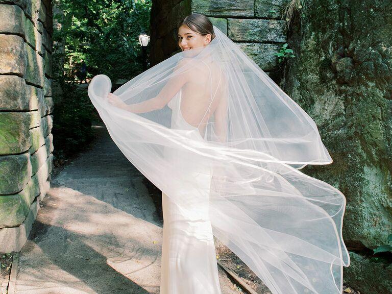Bride twirling veil on wedding day