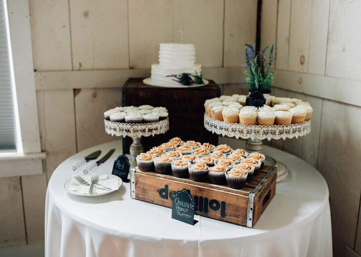 Heather and Brendan had a two-tier, white buttercream wedding cake that was flavored chocolate chip with peanut butter filling. They also had red velvet, butter rum and chocolate peanut butter cupcakes.