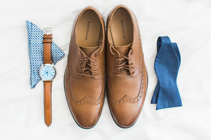 Kenneth jazzed up his custom Zara suit with brown wingtip oxfords, a patterned pocket square and a leather watch to achieve a classic yet fuss-free wedding day look.