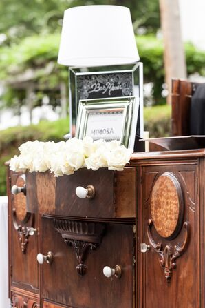 Ivory Roses in Antique Wooden Furniture