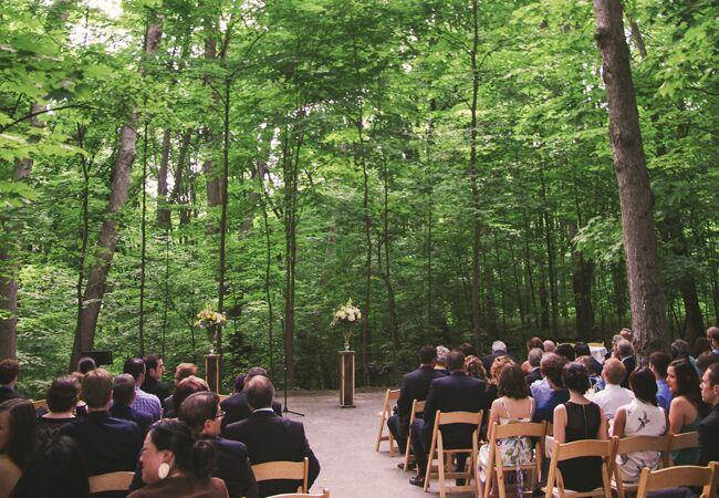 Woodland wedding ceremony backdrop: Nikki Mills / TheKnot.com