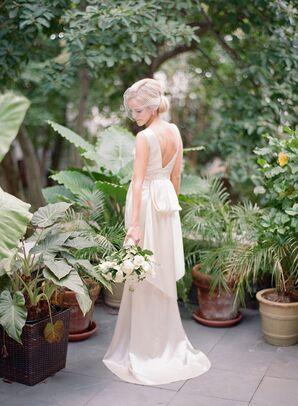 Bride in Ivory Backless Dress with Birdcage Veil