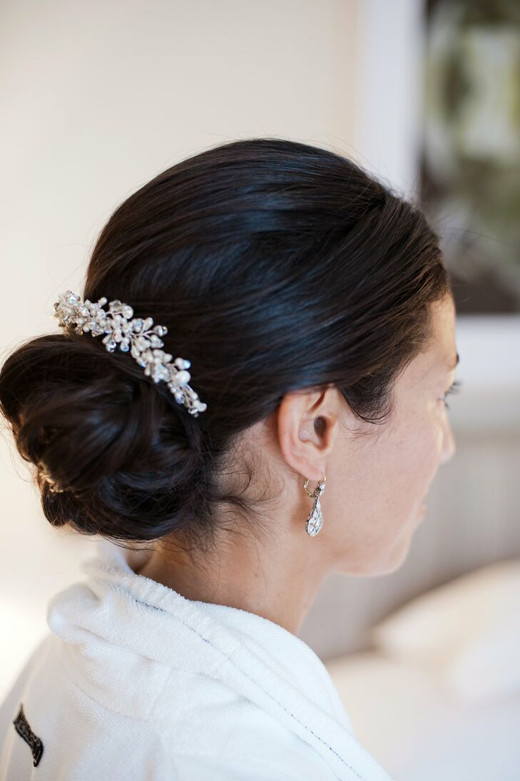 Christine wore her hair in a low updo with a crystal pin to finish the look.