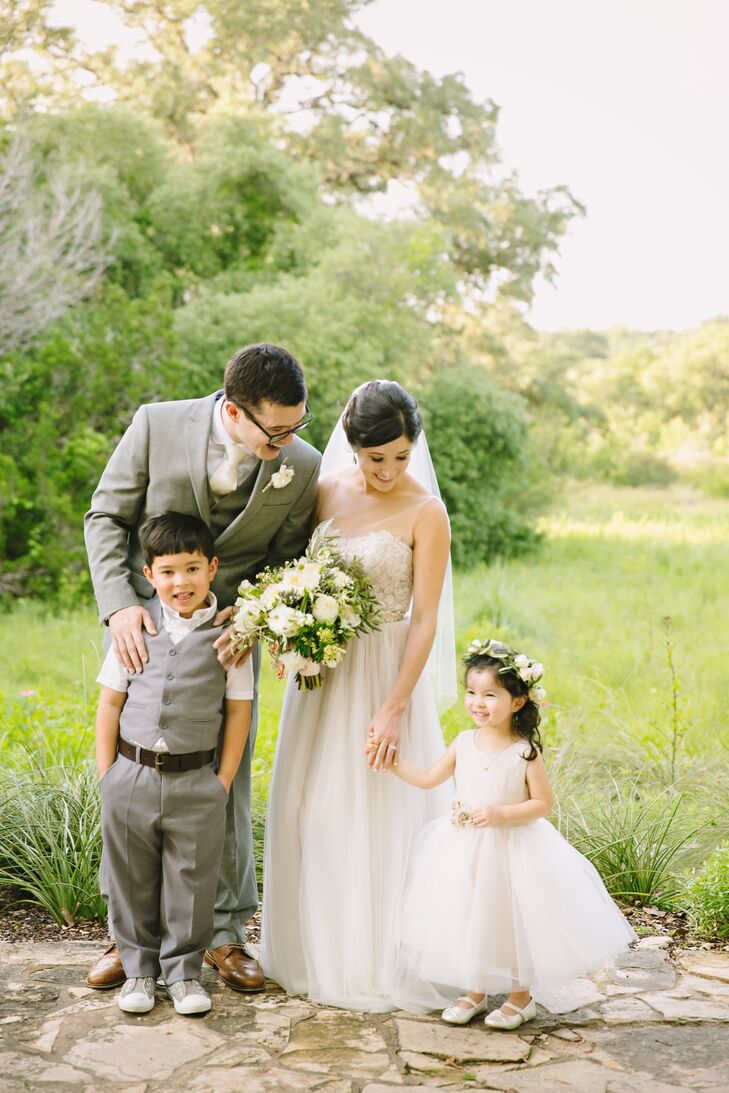 Justin and his groomsmen sported gray suits with a vest without a jacket. The ring bearer dressed to match, and the flower girl wore a custom flower crown.
