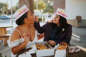 Couple Sharing Burgers During California Elopement