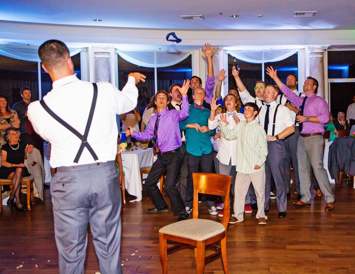 Groom Tosses Garter at Expecting Men