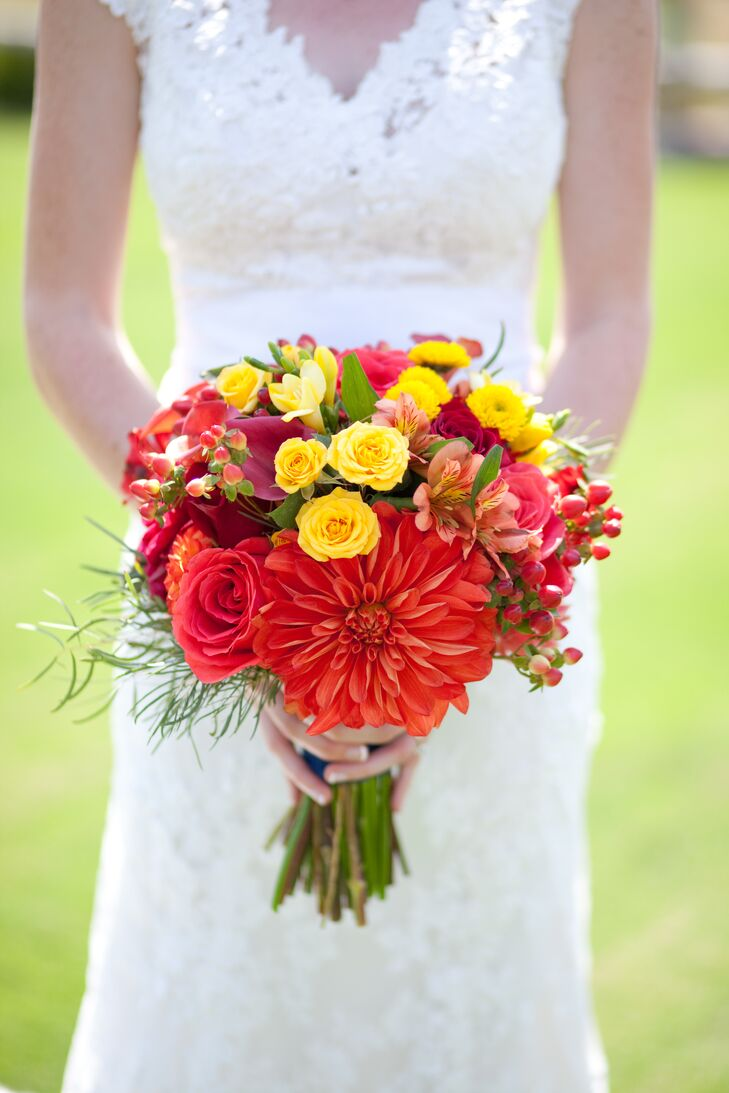 Wildflowers arranged the beautiful bouquets, including Sara's bridal arrangement, which popped with red, orange and yellow hues. The other arrangements matched this color scheme as well, which contrasted beautifully with the main light gray and navy blue wedding day colors.