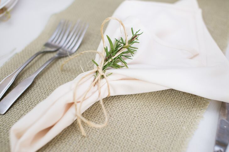 A single sprig of rosemary was tied to the napkins at each place setting.