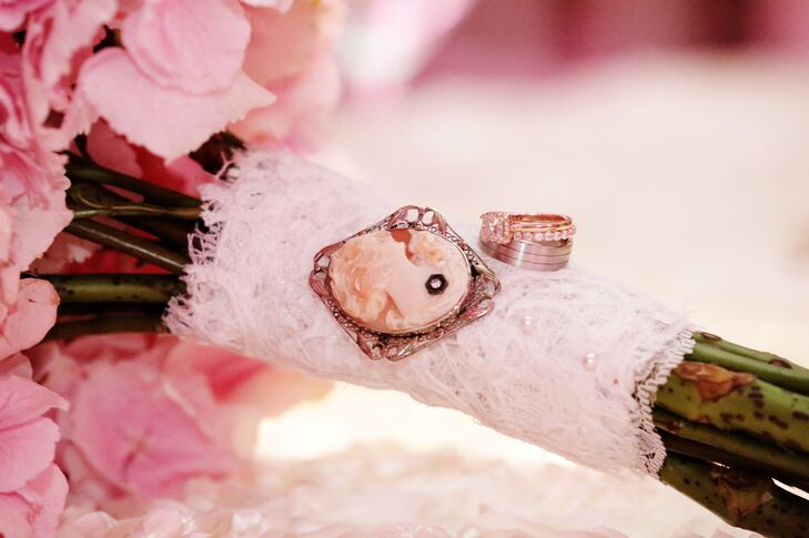 Olga's pink hydrangea and rose bouquet was wrapped with lace. It was accented with a vintage cameo and small white pearls.
