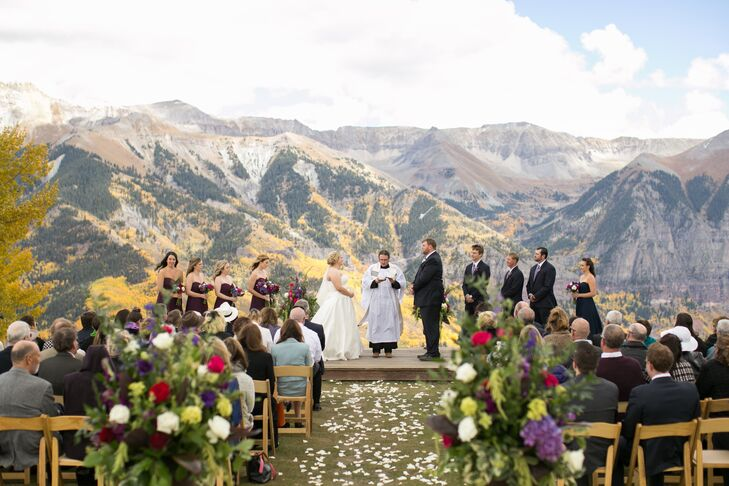 For their mountaintop ceremony at San Sophia Overlook, Margaret and Ryan decorated minimally, using only a few floral aisle arrangements and some scattered petals.