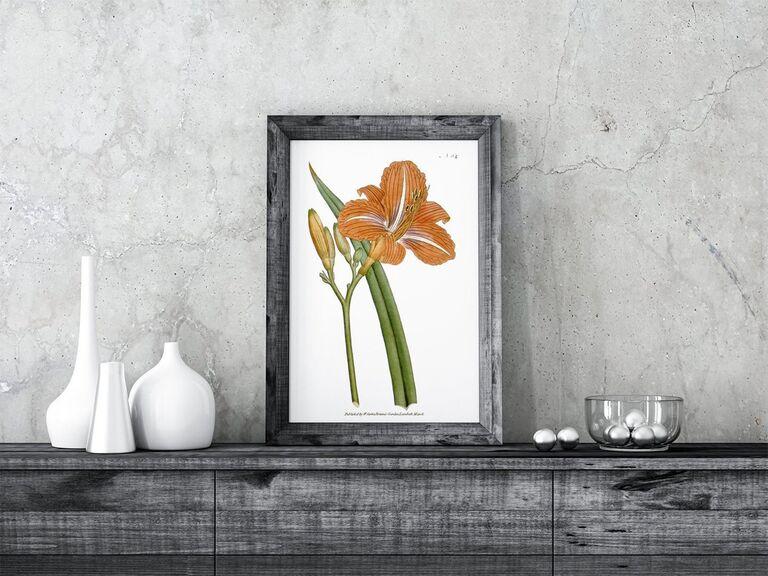 Framed vintage day lily art print on wooden dresser