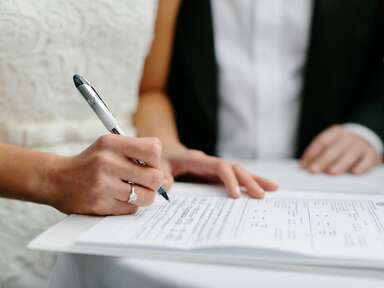 Bride signing marriage license