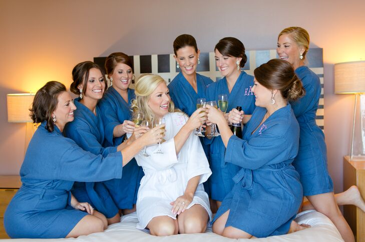 Her bridesmaids matched even before the ceremony began. Each woman was prepared for a morning focused on beauty and fun with blue robes, teardrop silver earrings and glasses of champagne.