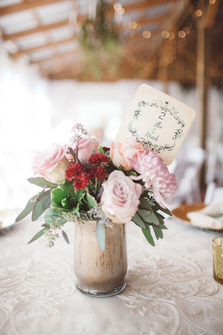Each table was set with a low arrangement of blush roses as well as blush and burgundy dahlias in a gold vintage style vase.