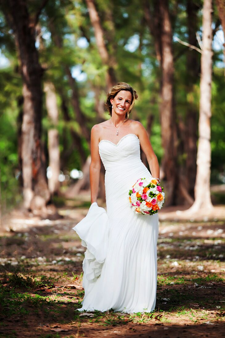 Christy's strapless Allure gown had chiffon gently ruched asymmetrically throughout the skirt.