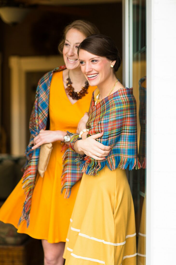 The bridesmaids draped colorful plaid shawls over their shoulders, which matched nicely with their vibrant yellow dresses.