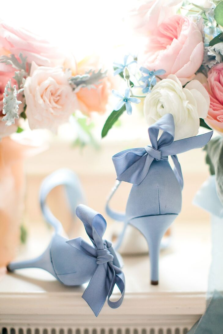 Brittany's Nina open-toed heels, embellished with a bow on the back, were her something blue.