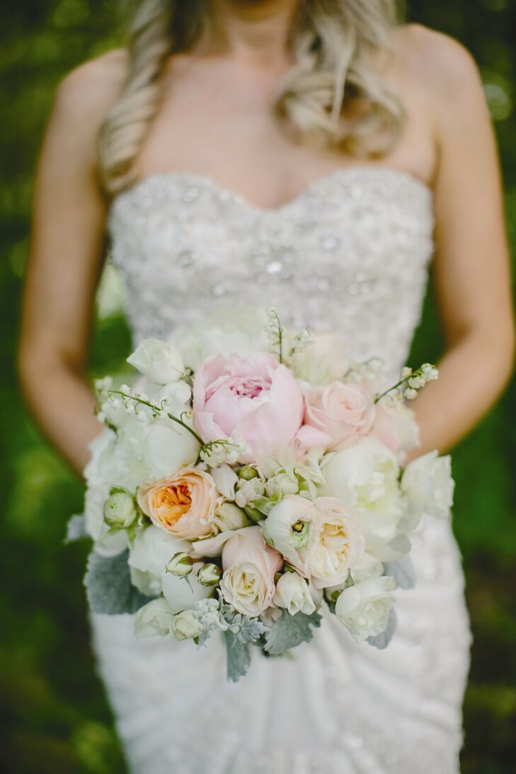 Kayla's soft bridal bouquet was an arrangement of roses, peonies, ranunculuses and lily of the valley.