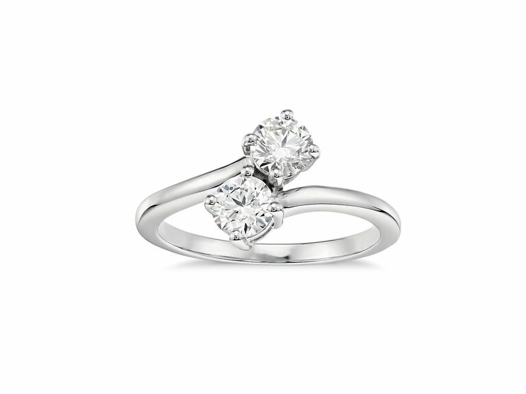 two stone ring with round diamonds in white metal setting
