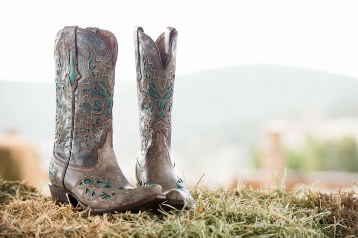 Keeping with their outdoorsy theme, the bride wore these cowboy boots down the aisle.