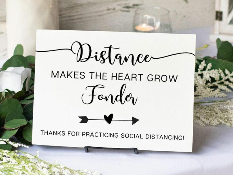 wooden social distancing sign