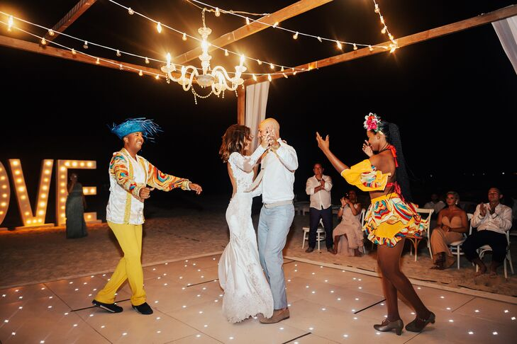 "Angelica and John danced to Nathan Sykes's ""Over and Over Again"" for their first dance as husband and wife. ""It was such a magical moment with a huge marquee 'Love' sign behind us and cold fire shooting out from the dance floor,"" the bride says."