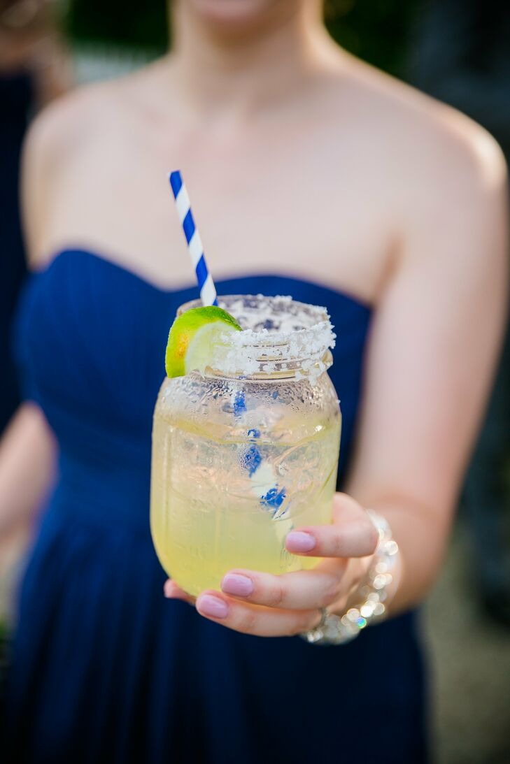 Served in a rustic mason jar with a nautical white-and-navy-striped straw, Callie chose margaritas as her signature cocktail.