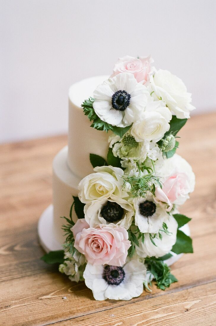 Whimsical Tiered Fondant Wedding Cake with Flowers