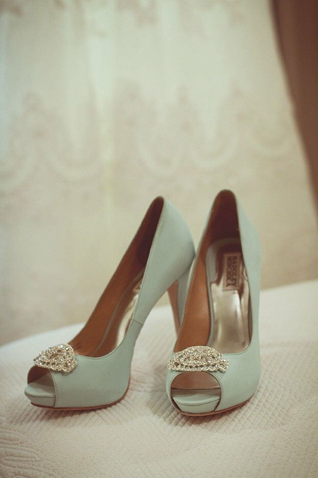 The bride wowed her guests in these mint colored Badgley Mischka peep-toe heels with a chain embellishment.