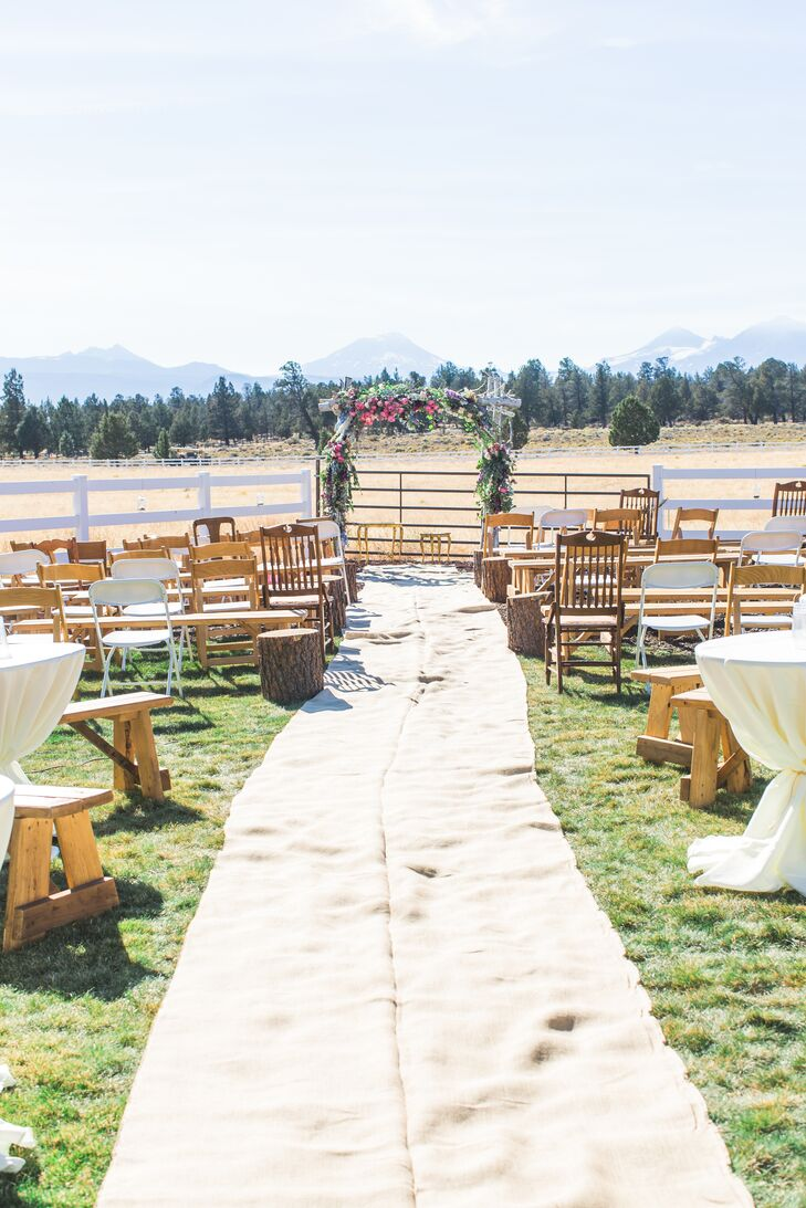 Long pieces of burlap were used as an aisle runner, accented with mason jars filled with tealights. Lanterns were set around the tables, which guests migrated to after the ceremony.